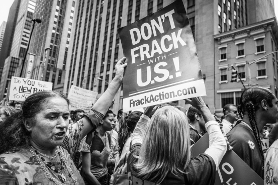 Photo Credit: Andrew Parker New York, USA - September 21, 2014: Black and white image of a woman protesting against fracking during the international Peoples Climate March demonstrating against global climate change and environmental degradation, Manhattan, New York, September 2014.